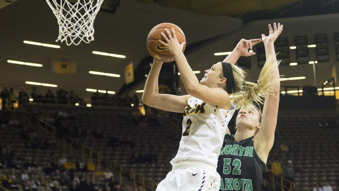 Ally Disterhoft drives around North Dakota's Stephanie Smith during the Hawkeyes' 83-61 victory at Carver Hawkeye Arena. Friday, November 13, 2015. Zak Neumann freelance for the Press Citizen.