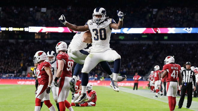 Los Angeles Rams running back Todd Gurley (30) celebrates after scoring a touchdown during the first half of an NFL football game against Arizona Cardinals at Twickenham Stadium in London, Sunday Oct. 22, 2017.