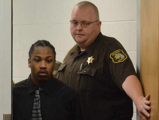 Christopher Felton enters the courtroom to begin the