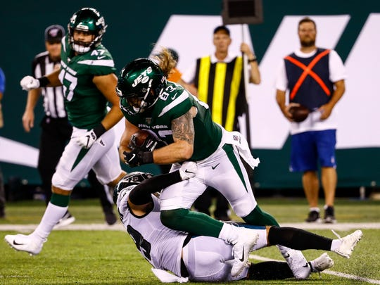 Alex Singleton #49 of the Philadelphia Eagles takes down Eric Tomlinson #83 of the New York Jets during the preseason game at MetLife Stadium on August 29, 2019 in East Rutherford, New Jersey. Singleton, a former Montana State star, was promoted to the Eagles' 53-man roster on Wednesday.