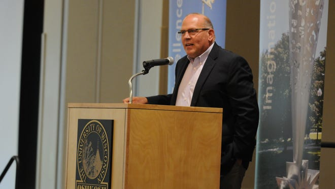 John Koker, dean of the University of Wisconsin-Oshkosh College of Letters and Science, speaks at a 2014 event to honor retiring Chancellor Richard Wells.
