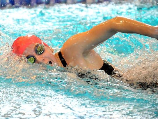 Chatham's Nicole Tingley swins the third leg of the