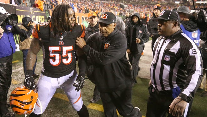 Cincinnati Bengals outside linebacker Vontaze Burfict is restrained by Cincinnati Bengals head coach Marvin Lewis as he gestures toward an official at the end of the Bengals' 18-16 loss to the Steelers.