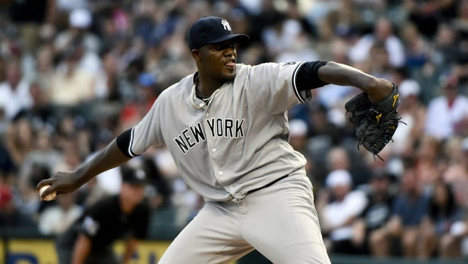 New York Yankees starting pitcher Michael Pineda delivers against the Chicago White Sox during the first inning of a baseball game in Chicago on Wednesday, July 6, 2016.