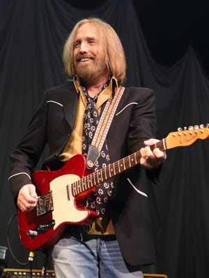 Tom Petty performs in concert.