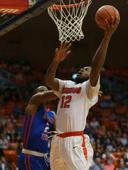 UTEP's Terry Winn scores against Louisiana Tech's Erik McCree during the second half Saturday.