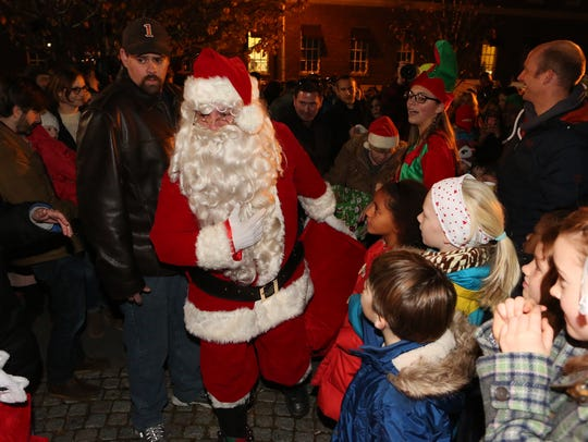 Santa arrives to distribute presents during the Holiday
