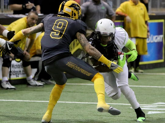 Wichita Falls Nighthawks' Norris Wrenn III tackles Nebraska Danger's Rob Brown Friday, May 5, 2017, in Kay Yeager Coliseum. The Nighthawks defeated the Danger 57-40.
