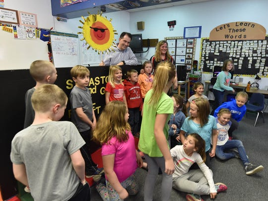 Holding one of the puppet show's props, Gov. Scott Walker talks to second graders at Sevastopol School following their presentation of a puppet show.  To see a photo gallery of the visit, go to www.doorcountyadvocate.com.