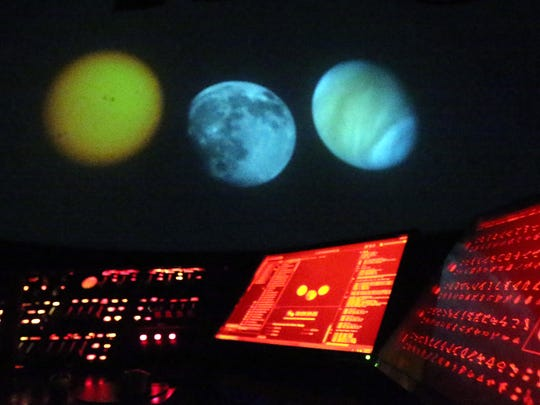 Celestial objects are projected onto the domed ceiling of the Gene Roddenberry Planetarium.