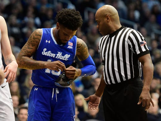 Seton Hall Pirates guard Myles Powell (13) fixes his