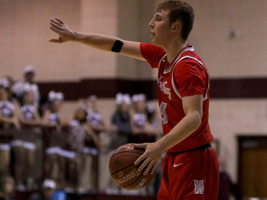 Holliday's Noah Parker communicates with his teammates in the game against Bowie Tuesday, Jan. 30, 2018, in Bowie.