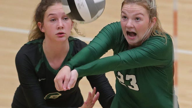 St. Vincent-St. Mary's Tara Lanham, right, collides with Lily Barker as she makes a play for the ball during the third set Thursday.