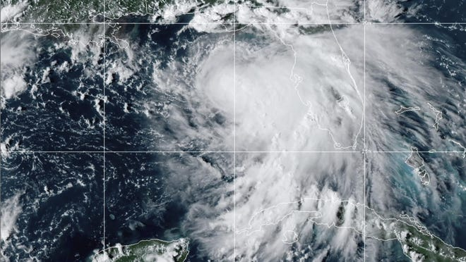 This satellite photo provided by the National Oceanic and Atmospheric Administration shows Tropical Storm Sally, Sunday, Sept. 13, 2020, at 2050 GMT. Sally churned northward on Sunday, poised to turn into a hurricane and send a life-threatening storm surge along the northern Gulf of Mexico.