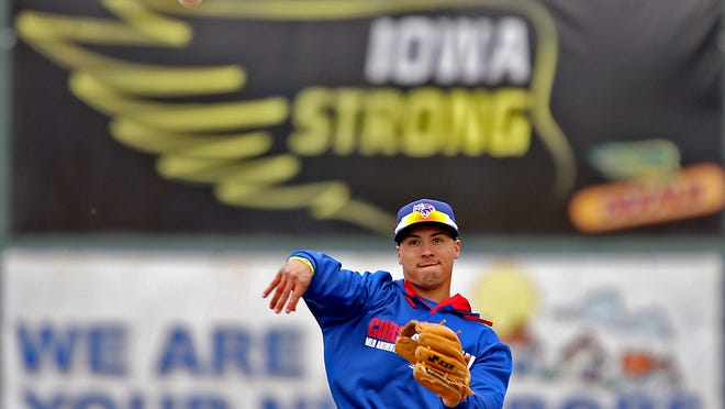 Iowa Cubs shortstop Javier Baez plays catch as he warms up at Principal Park in Des Moines. The Iowa Cubs, the triple-A affiliate of the Chicago Cubs, offer affordable entertainment for families.