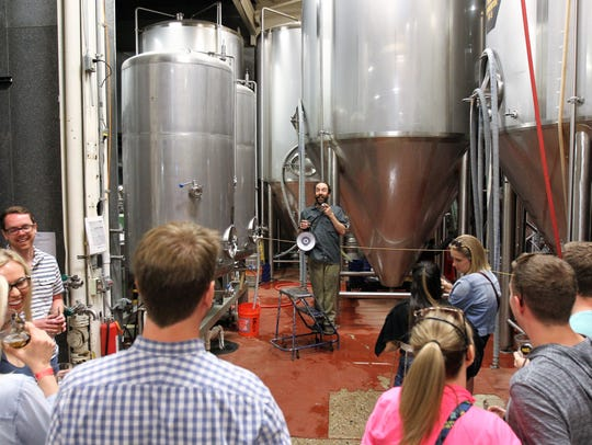 Milwaukee Brewing Co. tour guide Tim Higgins explains