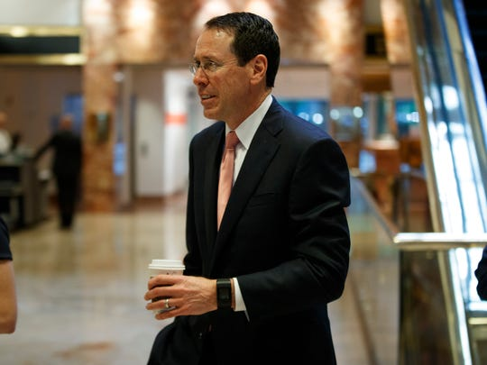 AT&T CEO Randall Stephenson arrives in the lobby of Trump Tower in New York Jan. 12, for a meeting with President-elect Donald Trump.