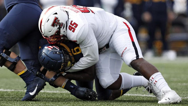 Sophomore nose tackle Jaylon Hutchings (95) is one of a handful of young defensive linemen whom Texas Tech will count on to emerge this season to make up for the loss of three-year starter Broderick Washington.