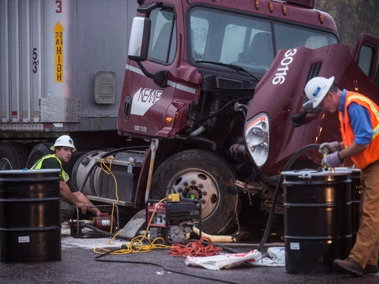 Right, Thomas Murphy with NRC -- an environmental clean-up company -- remove fuel from a tractor trailer involved in a fatal crash on U.S. 7 in Charlotte early Thursday morning.