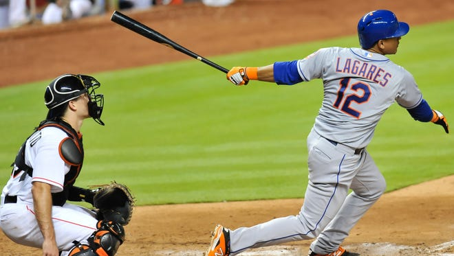 Juan Lagares connects for a two-run RBI triple during the eighth inning.