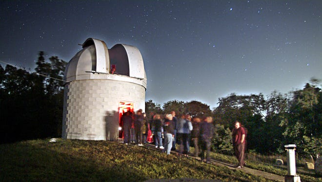 Cars filled parking lots in Boonton as people lined up to view Mars at the Sheep Hill Observatory.