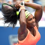 Serena Williams of the USA hits to Roberta Vinci of Italy on day twelve of the 2015 U.S. Open tennis tournament.