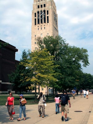 Students walk pass Burton Tower on the Ann Arbor campus of the University of Michigan.