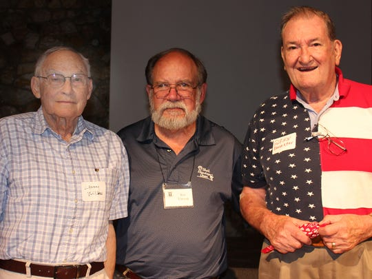 Larry Wilson, left, and Glenn Bannerman, right, pose with Ron Vinson.