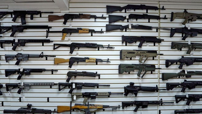 Dozens of semi-automatic rifles line a wall in a gun shop Tuesday, Nov. 7, 2017, in Lynnwood, Wash. Gun-rights supporters have seized on the Texas church massacre as proof of the well-worn saying that the best answer to a bad guy with a gun is a good guy with a gun. Gun-control advocates, meanwhile, say the tragedy shows once more that it is too easy to get a weapon in the U.S. (AP Photo/Elaine Thompson) ORG XMIT: WAET107