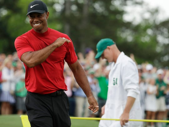 Tiger Woods reacts as he wins the Masters golf tournament Sunday, April 14, 2019, in Augusta, Ga. (AP Photo/Chris Carlson)