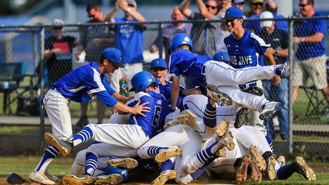 Middlesex celebrates after defeating Pennsville 4-3 in eight innings in the NJSIAA Group I baseball semi-final at Toms River North High School on June 5, 2018.
