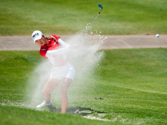 Minjee Lee blasts out of the sand during round four
