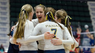 Walter Panas players cheer after a point scored in the first set during the Class A State Volleyball Finals.