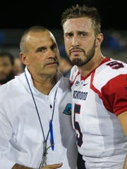 Danny Rocco consoles Richmond quarterback Kyle Lauletta - who played for Rocco when he coached the Spiders - after Delaware's 42-35, double-overtime win at Delaware Stadium in 2017. Lauletta now backs up Eli Manning with the New York Giants.