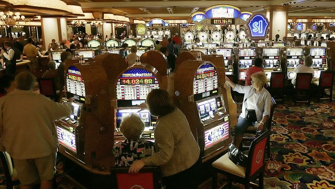 Gamblers play slot machines at Beau Rivage Resort and Casino in 2006 in Biloxi, Miss.