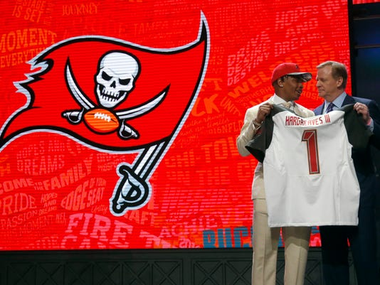 Florida's Vernon Hargreaves III poses for photos with NFL commissioner Roger Goodell after being selected by the Tampa Bay Buccaneers as the 11th pick in the first round of the 2016 NFL football draft, Thursday, April 28, 2016, in Chicago. (AP Photo/Charles Rex Arbogast)