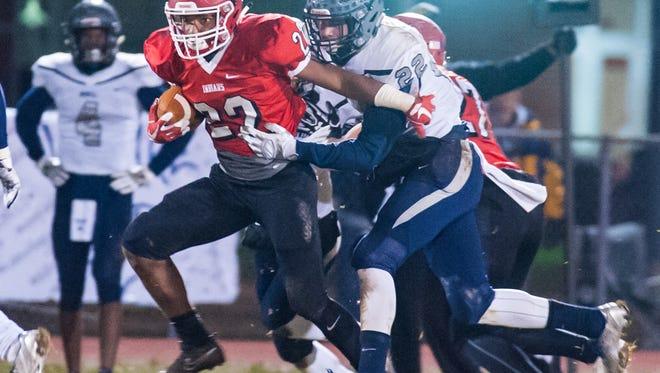 Lenape running back Jo Kellum (22) rushes against Howell at Lenape Regional High School on Friday, November 17.