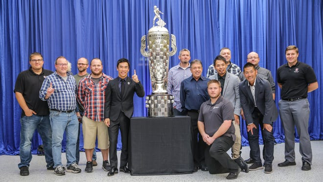 2017 Indy 500 winner Takuma Sato, center left, poses for photos with the Andretti Autosport No. 26 team during the Borg-Warner Trophy unveiling ceremony held at the Indianapolis Motor Speedway Museum on Tuesday. Sato won the 500 with the team in 2017, then later signed with Rahal Letterman.