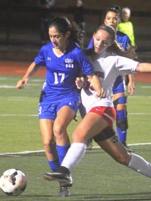 Hawthorne sophomore Alejandra Castillo (17) battling against Westwood in a state tournament game.