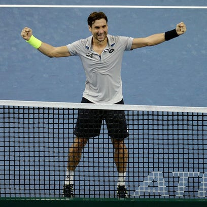 David Ferrer celebrates after defeating Feliciano Lopez in the final of the Malaysian Open.