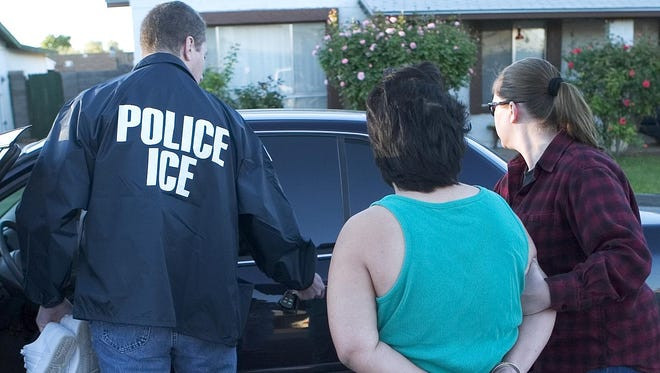 File photo. Immigration and Customs Enforcement agents take into custody a person believed to be an documented immigrants who had been convicted of a crime.