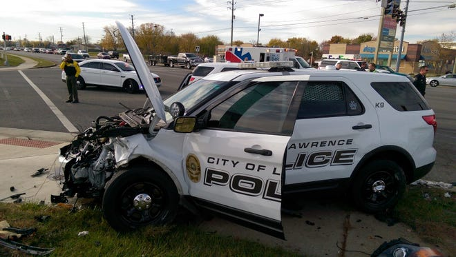 Lawrence police are investigating after an accident between a gray sedan and a Lawrence PD vehicle left one dead and another seriously injured Monday.