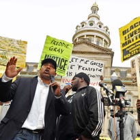 Edward Brown speaks Monday at a protest outside City Hall over the death of Freddie Gray after being taken into custody by Baltimore police.