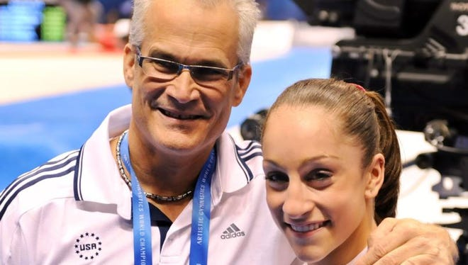 Jordyn Wieber and coach John Geddert, left, celebrated her all-around title at the World Gymnastics Championships in Tokyo on October 13, 2011.