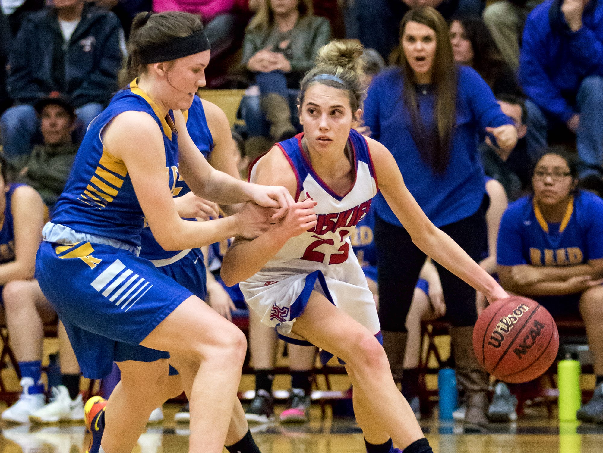 Reno Mikayla Shults drives against Red on FRiday night