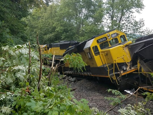 Flash flooding caused a train to derail in the Town