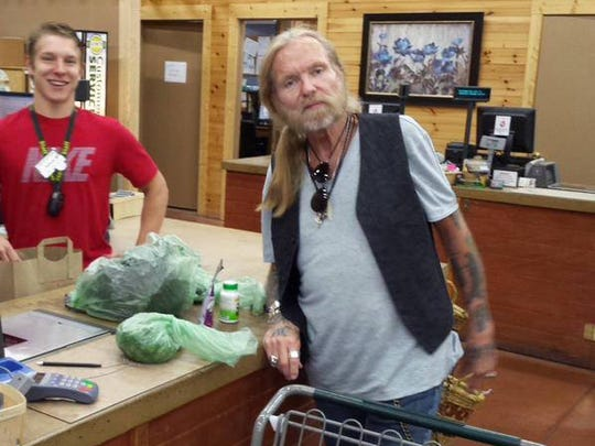2016 jazz fest headliner Gregg Allman, pictured in 2015 shopping at  Lori's Natural Foods in Henrietta. He was in town for a CMAC show.