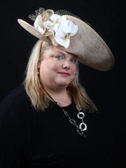 Jacquelyn Barber wears a hat that will be featured in this weekends Philadelphia Center auction.