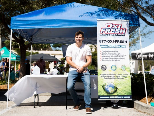 Charles Lawson, 27, a Naples High graduate, Iraq War vet and University of Miami graduate, is a franchisee of a new eco-friendly carpet cleaning business called Oxi Fresh in Naples. Lawson had a booth at the fifth annual Woofstock event hosted by the Naples Humane Society at Mercato on Sunday, March 26, 2017, in North Naples.