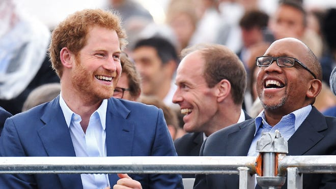 Prince Harry shares joke with Prince Seeiso of Lesotho at the Sentebale Concert for their children's charity at Kensington Palace on June 28, 2016 in London.